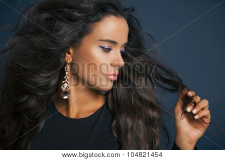 portrait of young woman with curly hair