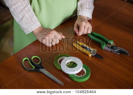Florist Tool In The Hands Of A Woman Making A Bouquet