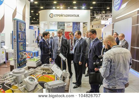 Business People Visiting The Exposition With The Product.