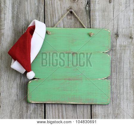 Sana hat hanging on blank wood sign