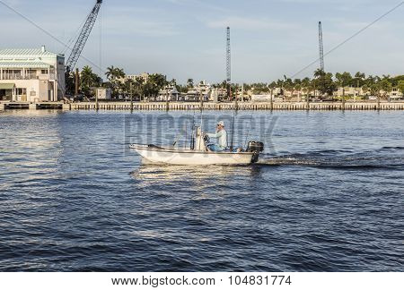 Fort Lauderdale, Usa - Aug 20, 2014: Man In Boat For Fishing By  Rods In The Canal In Fort Lauderdal