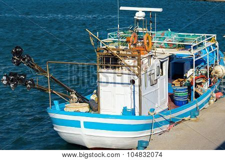 Traditional greek fishing boat at port of Aghia Galini on Crete island, Greece