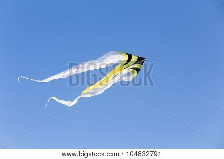 Giant Colorful Kite In The Blue Sky At The Summer Holidays Time