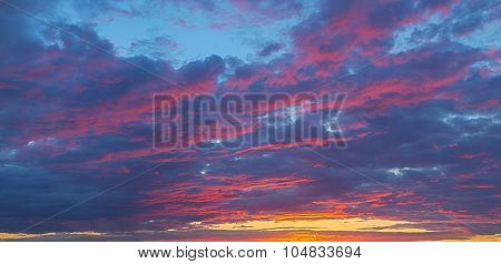 fantastic play of colors and shades of violet scarlet cloudy sky at sunset