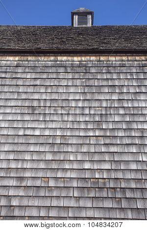 wood shingles on side and roof of barn