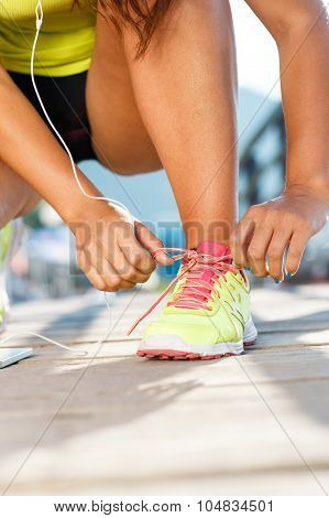 Running Shoes - Woman Tying Shoe Laces. Closeup Of Female Sport Fitness Runner Getting Ready For Jog