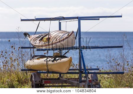 two kayaks on trailer by the ocean