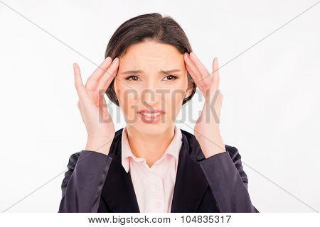 Business Woman Tired At Work. She Has A Headache
