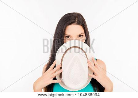Cute Shy Young Woman Hiding Her Face Behind Hat