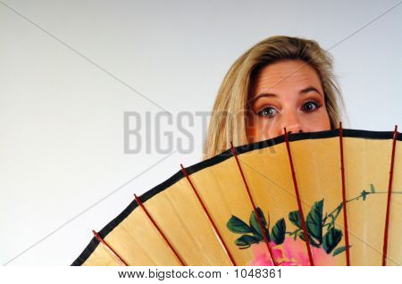 Woman Peeking Over Umbrella