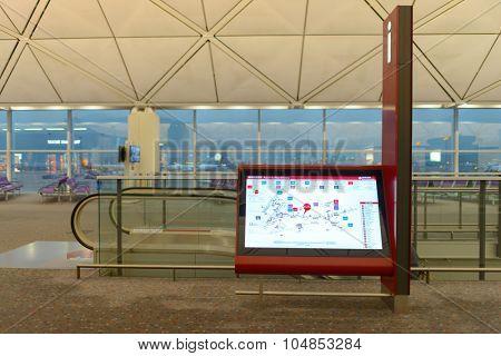 HONG KONG - APRIL 22, 2014: Hong Kong International Airport interior. Hong Kong International Airport is the main airport in Hong Kong. It is located on the island of Chek Lap Kok