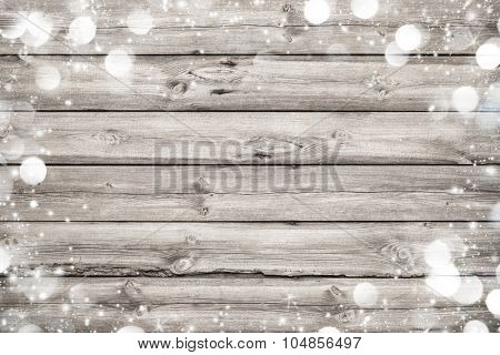 Christmas frame on wooden background with snow and lights