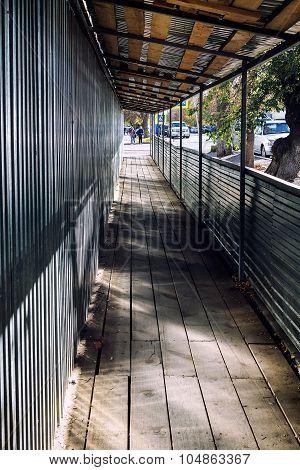 Pedestrian Wooden Walkway With Roofing