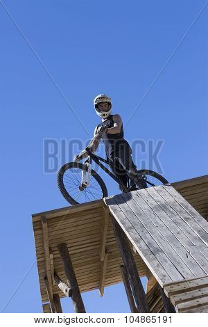 Bmx Bicycle Rider Ready To Jump.