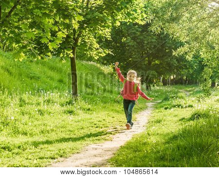 happy little girl go to school through the forest