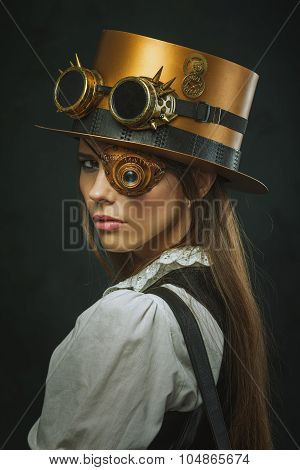 Close-up Portrait Of A Beautiful Girl Steampunk, Hat And Eyecup.