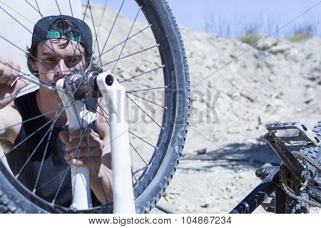 Cyclist Fixing The Bmx Bike Wheel