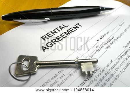 pen lying across a rental agreement