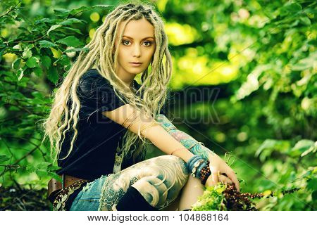 Romantic boho style girl in the wild wood. Boho, hippie fashion shot.