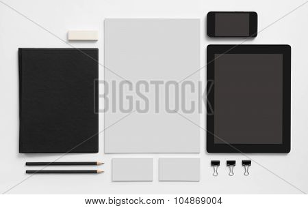 Set of stationery with tablet and mobile phone.