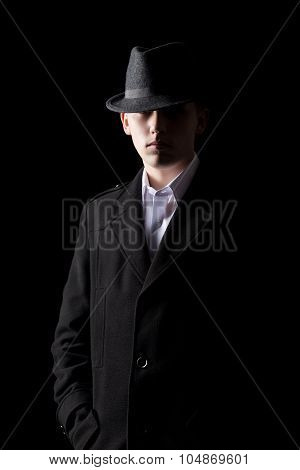 Handsome Man In Hat In The Dark