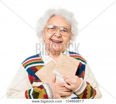 elderly woman holding old envelops isolated on white background
