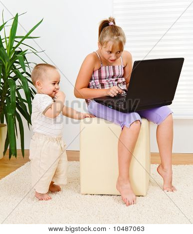 Sister And Brother With Computer