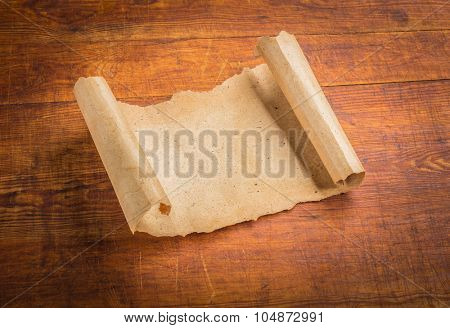 parchment scroll on wooden background.