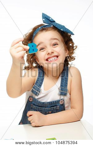 Little Girl Playing In The Alphabet. Shows The Letter B.