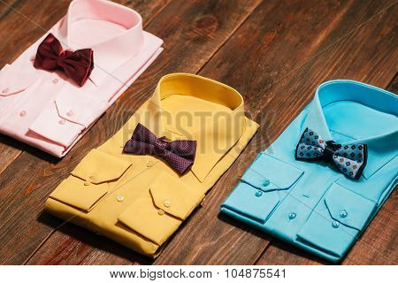 Set  Of  Men's Shirts With  Ties On A Wooden Background