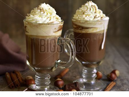 Hot Chocolate With Cinnamon And Hazelnuts In A Glass.