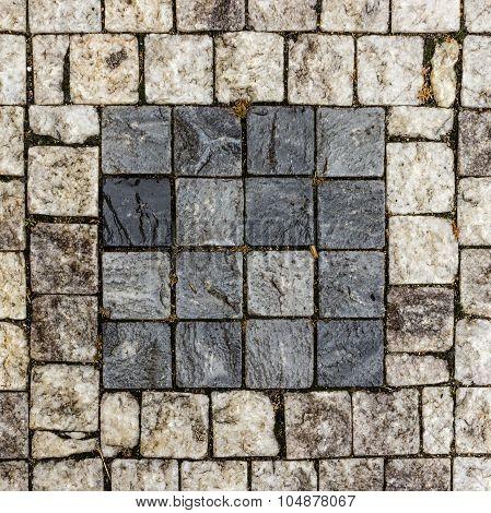 Pavement Of Granite Blocks Dark Square On A Light Background