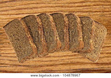 Slices Of Rye Bread On Chopping Board