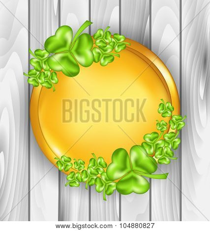 Golden coin with shamrocks. St. Patrick's day symbol, wooden tex