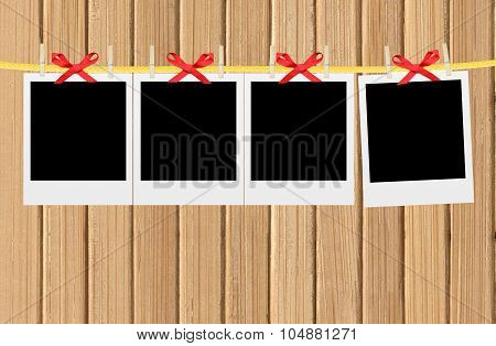 Old Photo Cards Hung With Wooden Hangers Over Wooden Wall Background