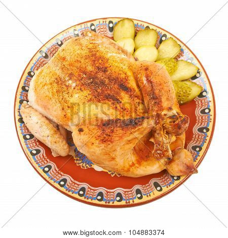 Fried Chicken On A Plate With Pickles On A White Background Isol