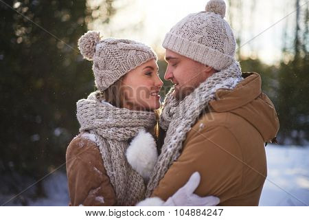 Amorous young couple having outdoor data on winter day