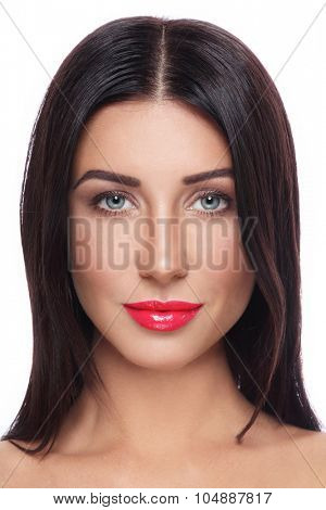 Portrait of young beautiful tanned woman with long straight hair and red lipstick over white background