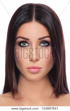 Portrait of young beautiful tanned brunette with long straight hair and stylish make-up over white background