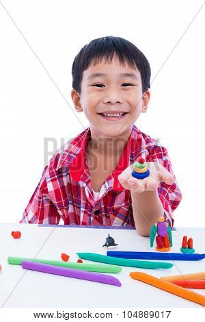 Child Smiling And Show His Works From Clay, On White Background. Strengthen The Imagination