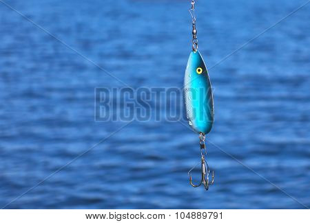 Fishing Spoon Over Waters.