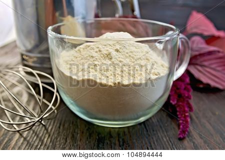Flour Amaranth In Glass Cup With Mixer On Board