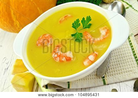 Soup-puree Pumpkin With Shrimp In White Bowl On Board