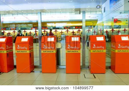KUALA LUMPUR, MALAYSIA - MAY 01, 2014: Firefly self check-in kiosks. Firefly is a full-service point-to-point carrier and a full subsidiary of Malaysia Airlines