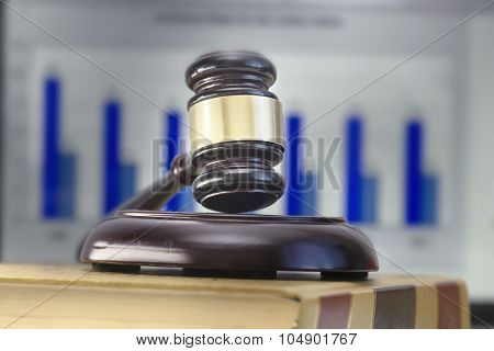 Legal law concept image gavel on book - laptop background