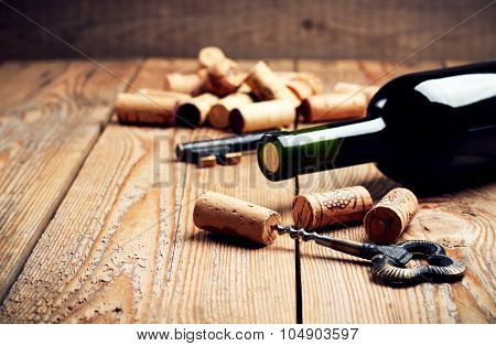 Wine Corks, Bottle And Corkscrew On A Wooden Table