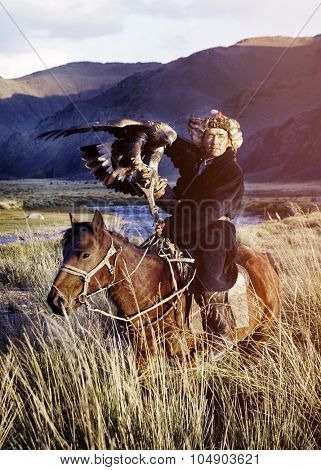 Kazakh on Horse With Eagle Catching Concept