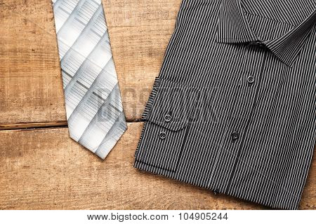 Shirt And Tie On A Wooden Table