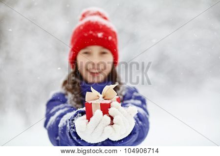 teenage girl with a gift in their hands