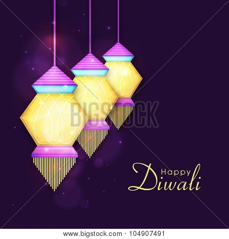 Colourful hanging illuminated lanterns or lamps on shiny purple background for Indian Festival of Lights, Happy Diwali celebration.